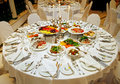 Laid table on reserved there are snacks and cutlery Royalty Free Stock Photography