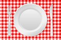 Laid table vector illustration of a with an empty plate and checkered tablecloth Stock Photos