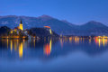 Lake Bled, castle Bled and church Assumption of the Virgin Mary - picture during the blue hour Royalty Free Stock Photo