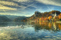 Lake Bled, Castle Bled, church St. Marina and church Assumption of the Virgin Mary Slovenia -an autumn picture Royalty Free Stock Photo