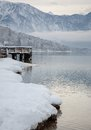 Lake bohinj landscape of the and wooden dock in winter with bad weather slovenia Royalty Free Stock Photo