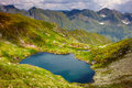 Lake capra in romania landscape with the fagaras mountains Stock Photos