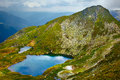 Lake capra in romania landscape with the fagaras mountains Royalty Free Stock Images