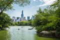 Lake in central park and New York city skyline. Royalty Free Stock Photo