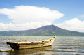 Lake chapala mexico wood fishing boat on with mountain behind Stock Images