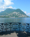 Lake and city of lugano switzerland picturesque view the with surrounding swiss alps in Stock Photography
