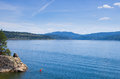 Lake coeur d alene kayaker kayak on viewed from tubbs hill on a sunny spring day Stock Photos