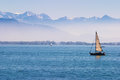 Lake of constance boats on the with the alps in the back ground Stock Photos