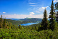Lake in dark coniferous taiga. Nature Park Ergaki. Royalty Free Stock Photo