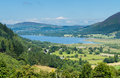 Lake district hills in bassenthwaite surrounding framed by the trees on the lakeside idyllic image from the english lakes Royalty Free Stock Photo