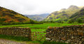 Lake district landscape scenic of with dry stone wall in foreground cumbria england Stock Images