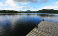 Lake district national park scenic view of with wooden pier in foreground cumbria england Royalty Free Stock Image