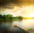 Lake in the evening wooden dock pier on a Royalty Free Stock Images