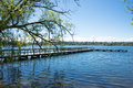 Lake with fishing pier in urban park copy space Royalty Free Stock Photos