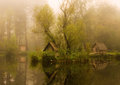 Lake fog a wonderful in the with small wooden buildings Stock Photo