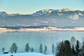 Lake forggensee winter landscape the in alpine by sunset allgäu alps bavaria germany frozen in wintertime Royalty Free Stock Photos