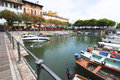 Lake garda desenzano italy promenade with fishing boats Royalty Free Stock Images
