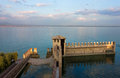 Lake garda panoramic sunset view from sirmione over the with scaliger fortress walls in the front Stock Image
