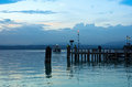 Lake Garda Pier and the Last Ferry for the day Royalty Free Stock Photo