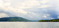 Lake George from the paddle boat during rain storm and clouds. Royalty Free Stock Photo