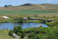Lake and hills view at hobbiton movie set matamata new zealand Stock Photos