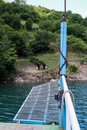 Lake Komani, Albania - May 18, 2017: Onboard morning Lake Komani ferry from Fierza to Koman in Albania - picking up people at a