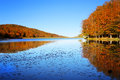Lake landscape autumn with colorful forest and Stock Images