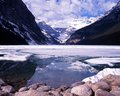 Lake louise alberta canada view across a partly frozen Royalty Free Stock Photo