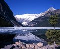 Lake louise alberta canada view across a partly frozen banff national park canadian rockies Royalty Free Stock Photo