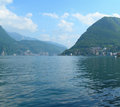 Lake lugano switzerland picturesque view of with surrounding swiss alps in Stock Images