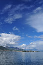 Lake maggiore italy spring sky blue and white clouds over lago Royalty Free Stock Images