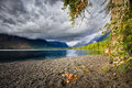 Lake mcdonald on a cloudy day ominous late afternoon clouds over in glacier national park Royalty Free Stock Images