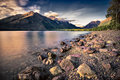 Lake mcdonald before sunset serene in glacier national park mt surrounded by mountains and a pine forest Royalty Free Stock Photos