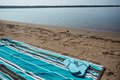 Lake Michigan Beach With Blue Flip Flops on Towel Royalty Free Stock Photo