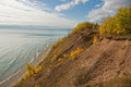 Lake michigan shore photograph of the high bank of an eroded shoreline with exposed dirt and vegetation trying to establish a Royalty Free Stock Photos