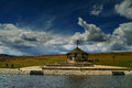 Lake mokra gora display part of the in with a beach of stone masonry wooden summer house which is used for off season storage Royalty Free Stock Photography