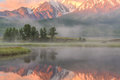 Lake mountains fog reflection dawn Royalty Free Stock Photo
