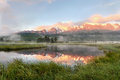 Lake mountains fog reflection sunrise Royalty Free Stock Photo