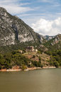Lake in the mountains of the pyrenees surrounded by tree with house is spanish province lleida on a sunny day it s a Royalty Free Stock Images