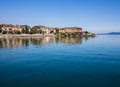 Lake neuchatel switzerland view of shoreline from the with deep blue sky and water Royalty Free Stock Photo