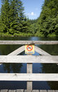 Lake with no swimming sign Stock Images