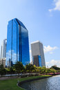 Lake and office buildings against blue sky bangkok thailand Royalty Free Stock Photo