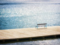 At the lake old wooden bench a Stock Images