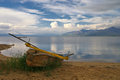 Lake prespa during spring the picture was made of in greece here i caught reflections of clouds alone boat and quiet great Royalty Free Stock Images