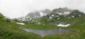 The lake psenodah and mountains pshekha su in cloudy weather panoramic view of Royalty Free Stock Image