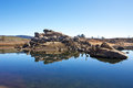 Lake reflections rock in jindaybyne snowy mountain high country australia Royalty Free Stock Photo
