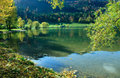 Lake schliersee reflecting hills in the water autumnal lakeside of Stock Photography