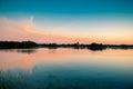 Lake sundown and sky nature at orange blue water trakai lithuania Royalty Free Stock Images