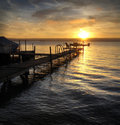 Lake sunrise a beautiful autumn on the shores of cayuga in the finger lakes region of new york state a pier that leads out to a Stock Photos