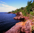 Lake superior cameo panoramic summer morning vista on colorful rock formations and trees along the north shore of minnesota Royalty Free Stock Photos